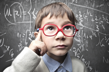 boy with glasses in deep thought